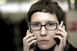 Woman holding two cell phones at once